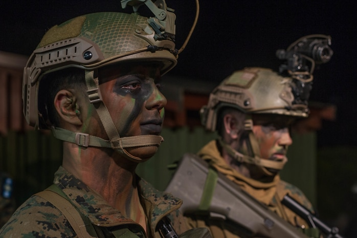 U.S. Marine Corps Lance Cpl. Jadon Valdez, left, a rifleman, and HM3 Cody Moody, right, a hospital corpsman, both with 1st Light Armored Reconnaissance Battalion, 1st Marine Division prepare for a night insert to an observation post during Exercise Southern Katipo 17 (SK17) at St. Arnaud, New Zealand, Oct. 24, 2017.