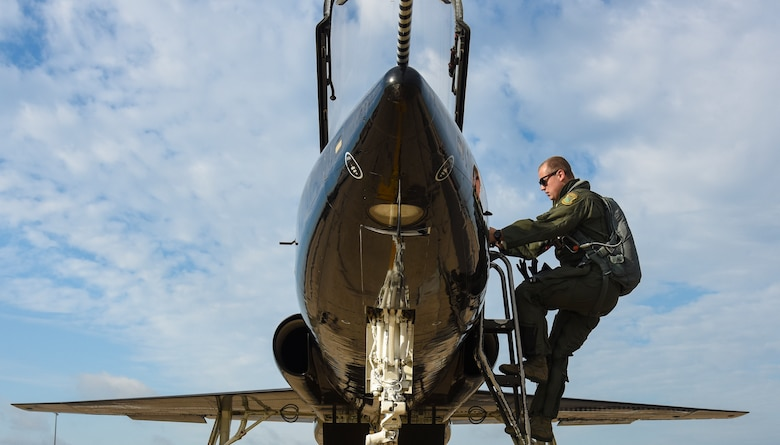 U.S. Air Force 1st Lt. Champ, 71st Fighter Training Squadron T-38 Talon pilot, boards an aircraft before flight at Joint Base Langley-Eustis, Va., Sept. 14, 2017.