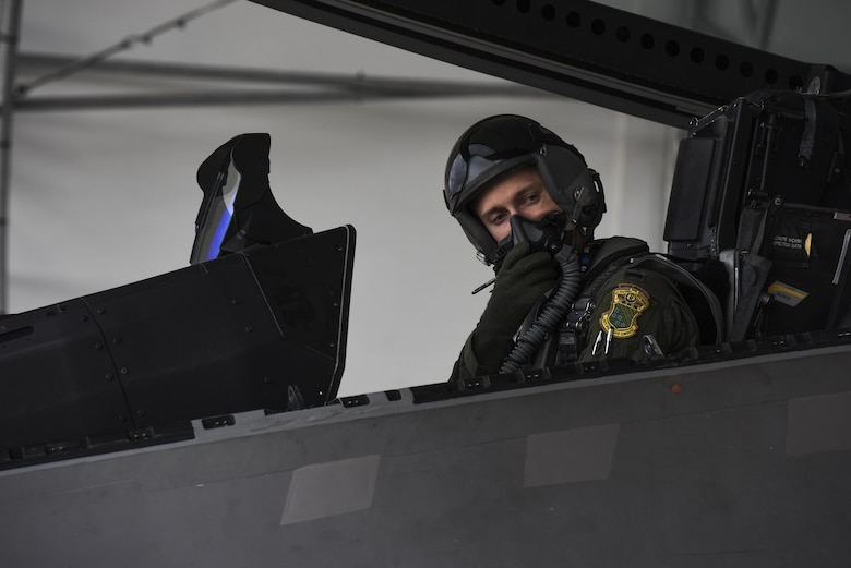 U.S. Air Force 1st Lt. Pen, 94th Fighter Squadron F-22 Raptor pilot, completes his preflight checklist before take-off at Joint Base Langley-Eustis, Va., Sept. 18, 2017.