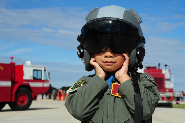 """A """"future aviator"""" covers his ears during a U.S. Air Force F-22 Raptor demonstration at the 1st Fighter Wing's Centennial Celebration Fall Festival at Joint Base Langley-Eustis, Va., Oct. 28, 2017."""