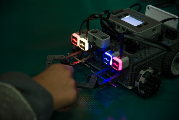 An attendee at Laughlin's first robot rodeo showcase their creations during cyber awareness week at Laughlin Air Force Base, Texas, Oct. 28, 2017. The purpose of the robot rodeo was to generate exposure to science, technology, engineering and mathematics careers, and to create an avenue to show off the base's and local community's robotic creations.