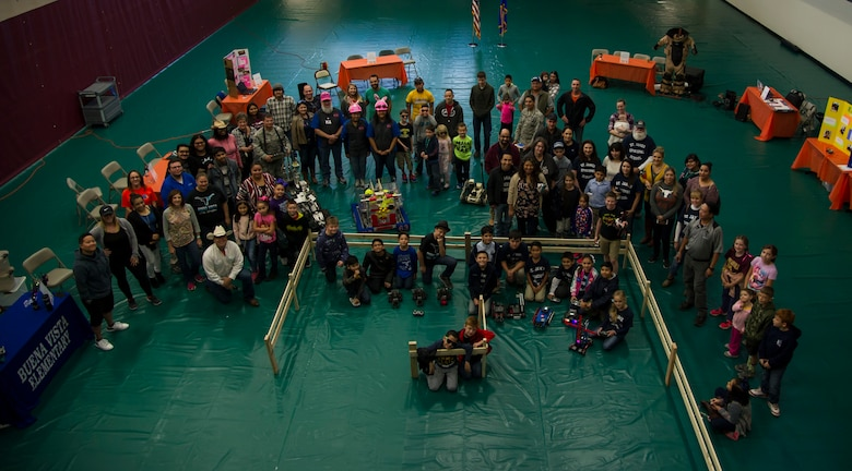 Attendees at Laughlin's first robot rodeo showcase their creations during cyber awareness week at Laughlin Air Force Base, Texas, Oct. 28, 2017. The purpose of the robot rodeo was to generate exposure to science, technology, engineering and mathematics careers, and to create an avenue to show off the base's and local community's robotic creations.