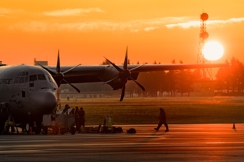 A crew chief assigned to the 374th Aircraft Maintenance Squadron walks on the flightline at Yokota Air Base, Japan, Oct. 26, 2017. Yokota received the C-130J Super Hercules from Dyess Air Force Base, Texas, and crew chiefs maintain the aircraft 24/7 during the Exercise Beverly Morning 17-06.