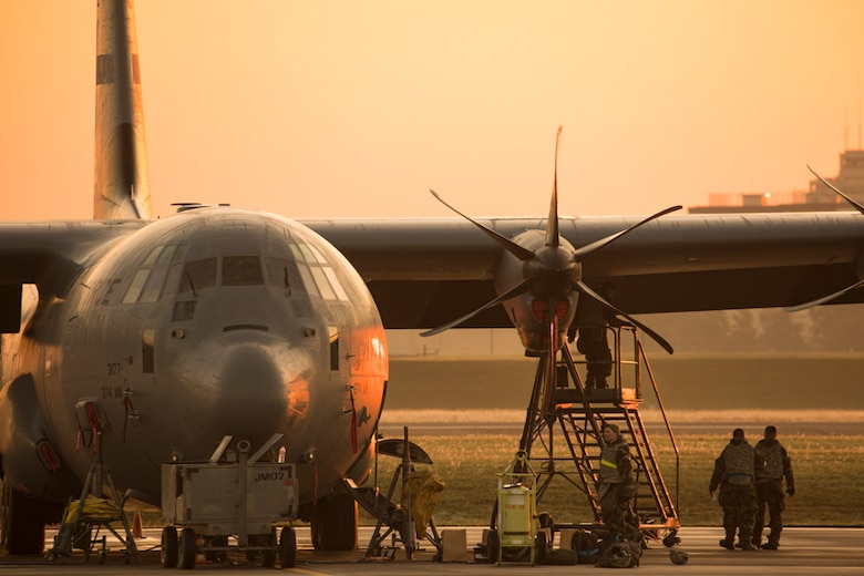 Crew chiefs assigned to the 374th Aircraft Maintenance Squadron maintain a C-130J Super Hercules during Exercise Beverly Morning 17-06 at Yokota Air Base, Japan, Oct. 26, 2017. Yokota received the C-130J from Dyess Air Force Base, Texas, and crew chiefs maintain the aircraft 24/7.