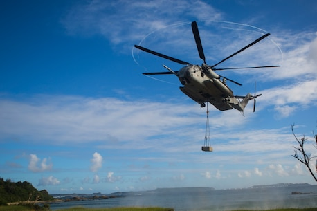 A U.S. Marine Corps CH-53E Super Stallion hovers over a landing zone with a cement block during an external lift drill with Marines from Combat Logistics Battalion 31 at Kin Blue Training Area, Camp Hansen, Okinawa, Japan, Oct. 19, 2017. CLB-31, the Logistics Combat Element of the 31st Marine Expeditionary Unit, provides logistic support to all elements of the MEU.