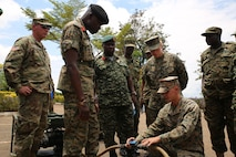 A U.S. Marine assigned to Special Purpose Marine Air-Ground Task Force Crisis Response-Africa logistics combat element host a static display after the graduation ceremony at Camp Jinja, Uganda, Oct. 13, 2017. SPMAGTF-CR-AF LCE service members facilitated an eight-week training mission in Uganda. SPMAGTF-CR-AF Marines deployed to conduct crisis-response and theater-security operations in Europe and Africa.  (U.S. Marine Corps Photo by Lance Cpl. Patrick Osino)
