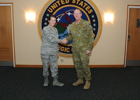 U.S. Air Force Maj. Gen. Nina Armagno, director of plans and policy for U.S. Strategic Command (USSTRATCOM), welcomes Australian Army Maj. Gen. Marcus Thompson, Deputy Chief Information Warfare for the Australian Defence Force, to USSTRATCOM headquarters at Offutt Air Force Base, Neb., Oct. 27, 2017. During his visit, Thompson met with senior leaders and subject matter experts for discussions on areas of collaboration and USSTRATCOM's missions. One of nine Department of Defense unified combatant commands, USSTRATCOM has global responsibilities assigned through the Unified Command Plan that include strategic deterrence, space operations, cyberspace operations, joint electronic warfare, global strike, missile defense and intelligence.