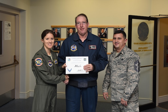 """Edward Proffit, 47th Student Squadron T-6 Texan II civilian simulator instructor and phase one handler, was chosen by wing leadership to be the """"XLer"""" for the week of Oct. 18, 2017. The """"XLer,"""" a wing-level program, is awarded to those who consistently make outstanding contributions to their unit and Laughlin's mission. (U.S. Air Force photo/Airman 1st Class Anne McCready)"""