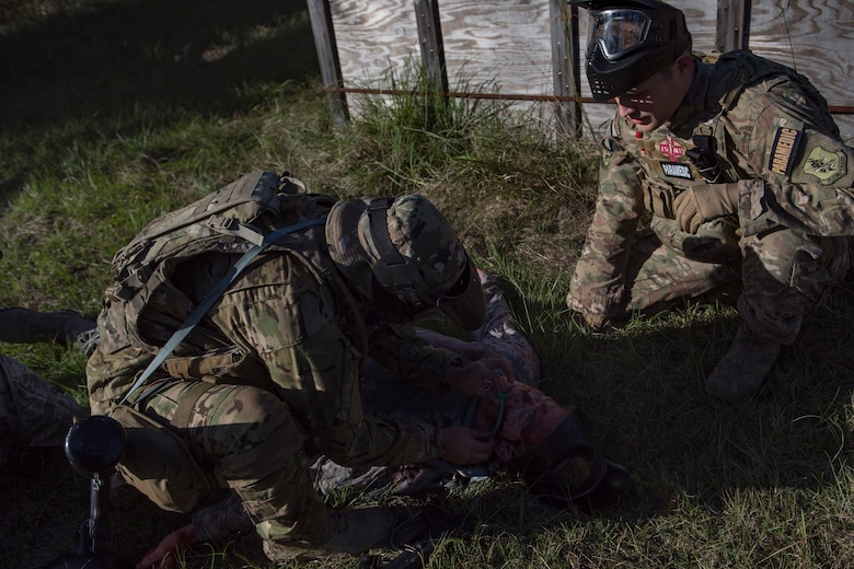 Staff Sgt. Cory Newby, 347th Operations Support Squadron Independent Duty Medical Technician paramedic, observes a student applying Tactical Combat Causality Care during training, Oct. 25, 2017, at Moody Air Force Base, Ga. The new, three-day combined training is designed to merge many smaller courses and seamlessly tie together skills that could be used in the event that Airmen become isolated during a mission. (U.S. Air Force photo by Senior Airman Daniel Snider)