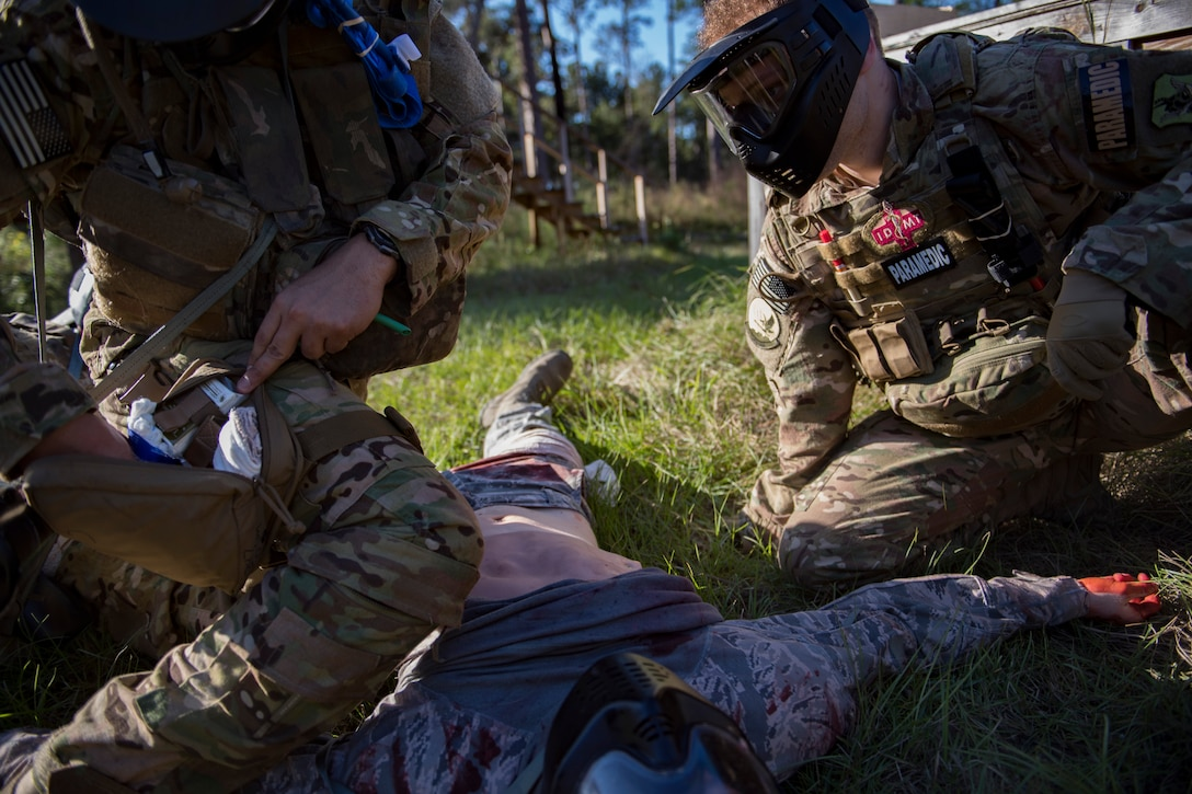 Staff Sgt. Cory Newby, 347th Operations Support Squadron Independent Duty Medical Technician paramedic observes a student applying Tactical Combat Causality Care during training, Oct. 25, 2017, at Moody Air Force Base, Ga. The new, three-day combined training is designed to merge many smaller courses and seamlessly tie together skills that could be used in the event that Airmen become isolated during a mission. (U.S. Air Force photo by Senior Airman Daniel Snider)