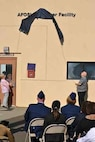 Parents of AFOSI Fallen SA David Wieger unveil the sign naming the AFOSI Det. 303 building in their son's honor.