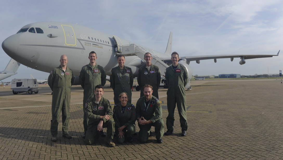 U.S. Air Force KC-135 Stratotanker aircrew, assigned to RAF Mildenhall, England, and Royal Air Force A330 Voyager aircrew stand in front of an RAF Voyager Nov. 1, 2017, on the flight line at RAF Brize Norton, England. The NATO allies executed the first KC-135 and RAF Voyager cell aerial refueling when two RAF Tornado GR4s received fuel off the east coast of Scotland. (U.S Air Force photo by Senior Airman Justine Rho)