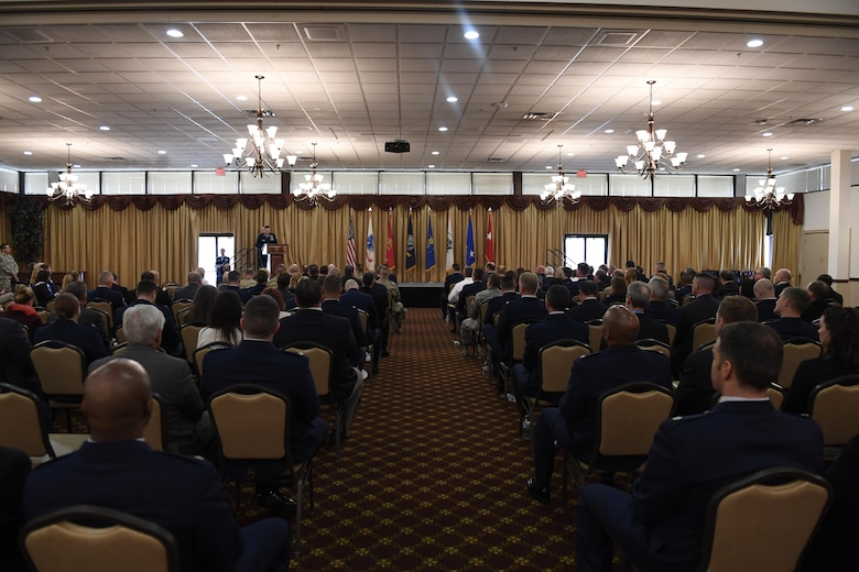 Leaders from organizations across Joint Base MDL are introduced to their new honorary commanders during the Honorary Commander Induction Ceremony here, Oct. 30, 2017. The Honorary Commander Program provides local community leaders an opportunity to experience military culture and view first-hand the many different missions across the installation; allowing them to return to their communities with insight into the inherent value of Joint Base MDL. (U.S. Air Force photo by Airman 1st Class Zachary Martyn)