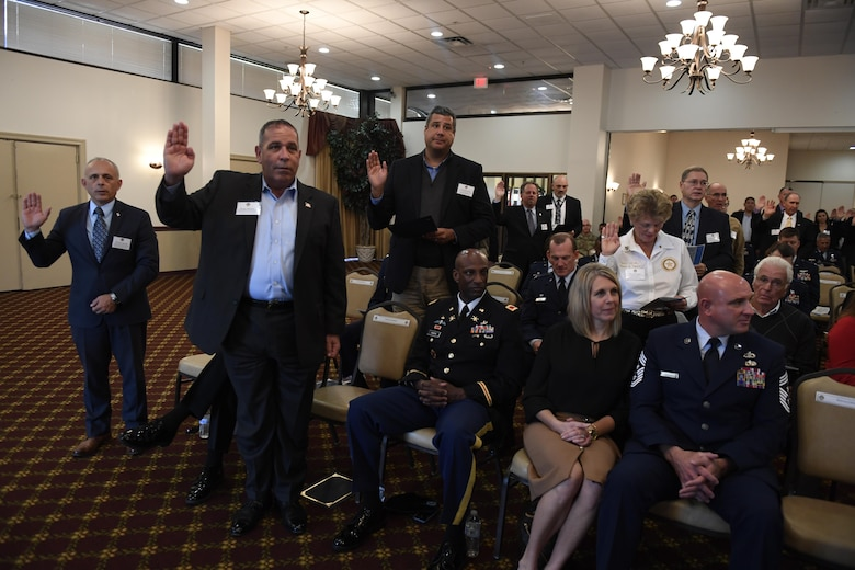 Local community leaders are sworn in as Honorary Commanders during the Honorary Commander Induction Ceremony at Joint Base McGuire-Dix-Lakehurst, N.J., Oct. 30, 2017. The freshly sworn in Honorary Commanders were provided an opportunity to tour Joint Base MDL and witness the diverse mission set here; for some, this was their first time exploring a military installation. (U.S. Air Force photo by Airman 1st Class Zachary Martyn)