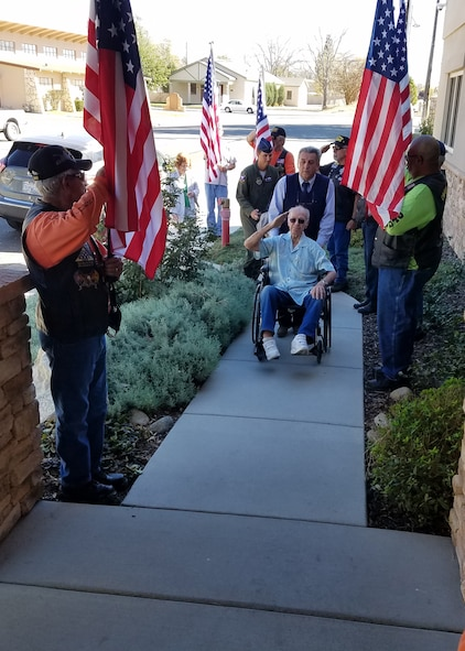 Capt. Bob Wood, a WWII bomber pilot, arrives at Tehachapi Police Department in Tehachapi, Calif., followed by Lt. Col. Miles Middleton, 419th Flight Test Squadron commander, during a tour honoring the WWII vet Oct. 28. (U.S. Air Force photo by Steve Zapka)