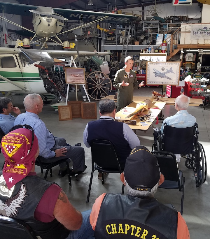 Lt. Col. Miles Middleton, 419th Flight Test Squadron commander, thanks Capt. Bob Wood for his service. Wood is a decorated WWII B-17 bomber pilot who flew 35 Combat missions over Europe. Middleton is a B-52 pilot.