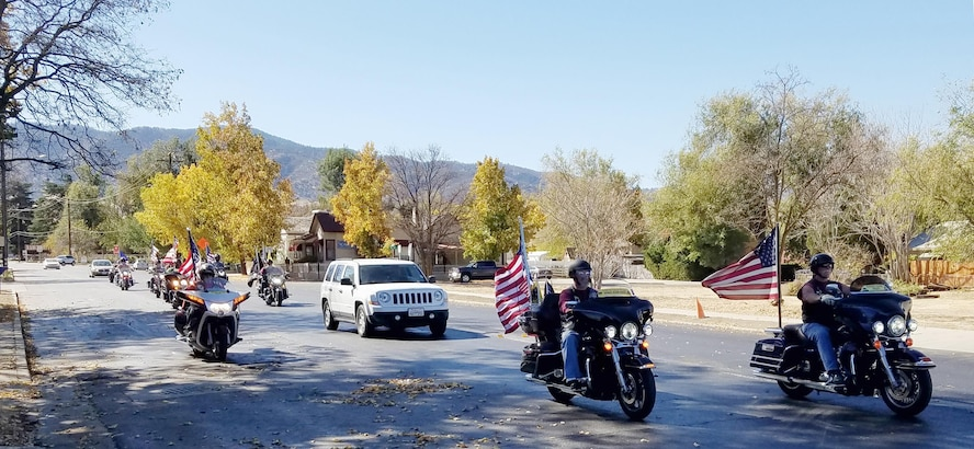 Patriot Guard Riders escort Capt. Bob Wood, a WWII B-17 pilot, to Tehachapi Airport, for a visit to an aircraft restoration hangar during an event honoring Wood's service. (U.S. Air Force photo by Steve Zapka)