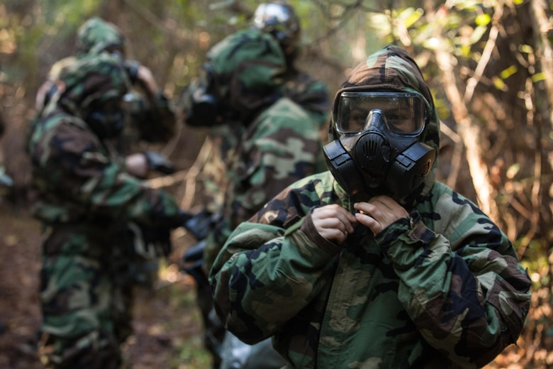 U.S. Marines with the 26th Marine Expeditionary Unit (MEU), don Mission Oriented Protective Posture gear during a chemical, biological, radiological, nuclear training event at Camp Lejeune, N.C., Oct. 30, 2017.