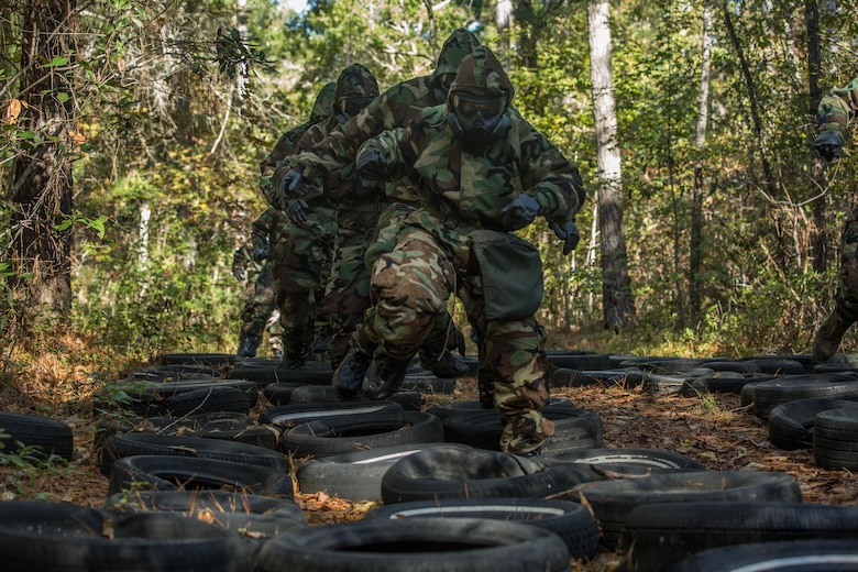 U.S. Marines with the 26th Marine Expeditionary Unit (MEU), run through an obstacle course wearing full Mission Oriented Protective Posture during a chemical, biological, radiological, nuclear training event at Camp Lejeune, N.C., Oct. 30, 2017.