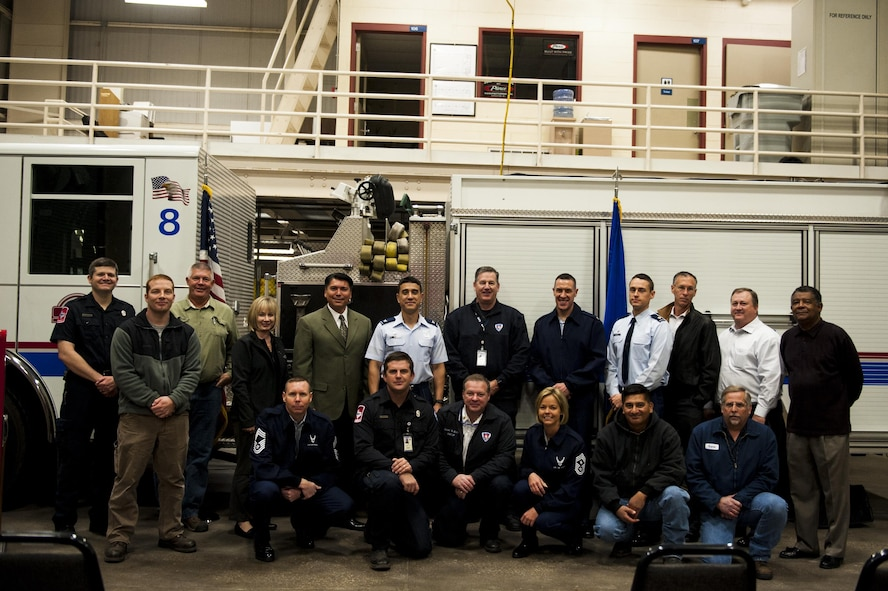 Members of the 17th Logistics Readiness Squadron, the 17th Mission Support Group, the 17th Training Wing leadership and San Angelo city leadership stand together in Goodfellow's firetruck maintenance facility on Goodfellow Air Force Base, Texas, Oct. 31, 2017. Everyone featured in the photo helped to reaffirm the memorandum of agreement between the city of San Angelo and Goodfellow. (U.S. Air Force photo by Senior Airman Scott Jackson/Released)