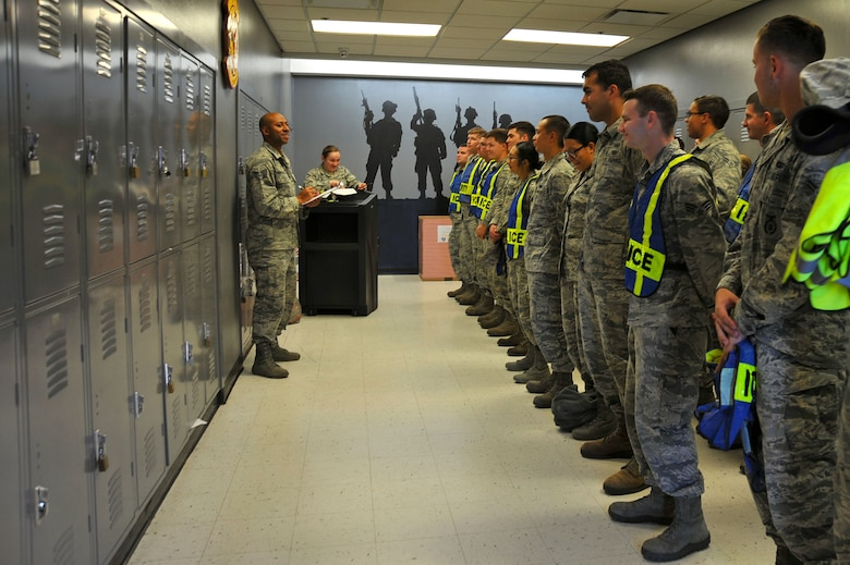 U.S. Airmen assigned to the 20th Fighter Wing stand for roll call before trick-or-treating at Shaw Air Force Base, South Carolina, Oct. 31, 2017.