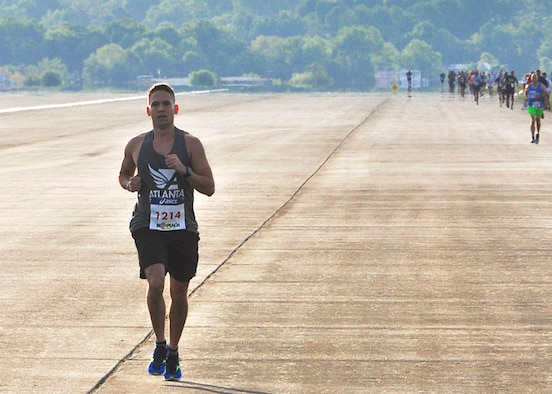 A runner in the 2016 Falcon 5K runs on the flightline at Dobbins Air Reserve Base, Ga. September 11, 2016. (U.S. Air Force photo/Master Sgt. James Branch)