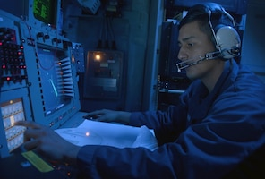 IMAGE: MEDITERRANEAN SEA - Cryptologic Technician (Technical) 2nd Class David J. Aguilera monitors the electromagnetic spectrum of air and surface contacts in the combat information center aboard the guided-missile destroyer USS Ramage (DDG 61). The Navy is refocusing efforts to deploy new electromagnetic maneuver warfare technologies under development for integration in the Fleet and its carrier strike groups, the Naval Surface Warfare Center Dahlgren Division announced, Nov. 1, 2017.