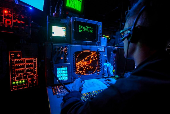 IMAGE: U.S. 5TH FLEET AREA OF RESPONSIBILITY – Operations Specialist 2nd Class Alex Moore monitors radars to identify aircraft in the Combat Information Center aboard the multipurpose amphibious assault ship USS Bataan (LHD 5). The Navy is refocusing efforts to develop and deploy new technologies impacting electromagnetic maneuver warfare, including radar, for integration in the Fleet and its carrier strike groups, the Naval Surface Warfare Center Dahlgren Division announced, Nov. 1, 2017.