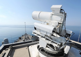 IMAGE: 141117-N-PO203-072  ARABIAN GULF (Nov. 17, 2014) The Afloat Forward Staging Base (Interim) USS Ponce (ASB(I) 15) conducts an operational demonstration of the Office of Naval Research (ONR)-sponsored Laser Weapon System (LaWS) while deployed to the Arabian Gulf. (U.S. Navy photo by John F. Williams/Released)