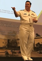 IMAGE: KING GEORGE, Va. (Sept. 26. 2017) – Naval Surface Warfare Center Commander Rear Adm. Tom Druggan tells the Electromagnetic Maneuver Warfare (EMW) Systems Engineering and Acquisition Conference audience that the Navy is renewing its focus on EMW for sea control and victory at sea. Industry, academia, and Department of Defense experts collaborated and discussed the advancement of electromagnetic warfare throughout the three-day event, sponsored by the Association of Old Crows and NSWC Dahlgren Division. (Courtesy photo by Shelley Frost/Released)