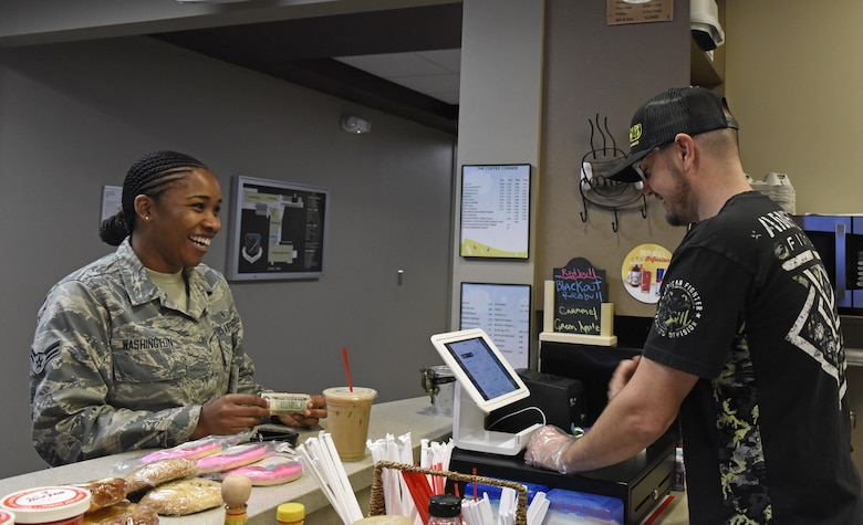Larry Bowman, U.S. Air Force retiree and owner of the Coffee Corner, cashes out a customer at Fairchild Air Force Base, Wash., Sept. 26, 2017. Bowman enlisted July 2001, and was stationed at Fairchild for 14 years, during which he was a flight chief for a section of crew chiefs and deployed overseas seven times. He retired June 2015, and stayed in the local area. (U.S. Air Force photo/Airman 1st Class Jesenia Landaverde)