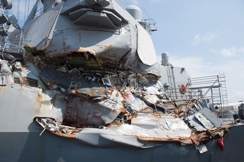The guided missile destroyer USS Fitzgerald sits in Dry Dock 4 at Fleet Activities Yokosuka, Japan, for repairs and damage assessments.