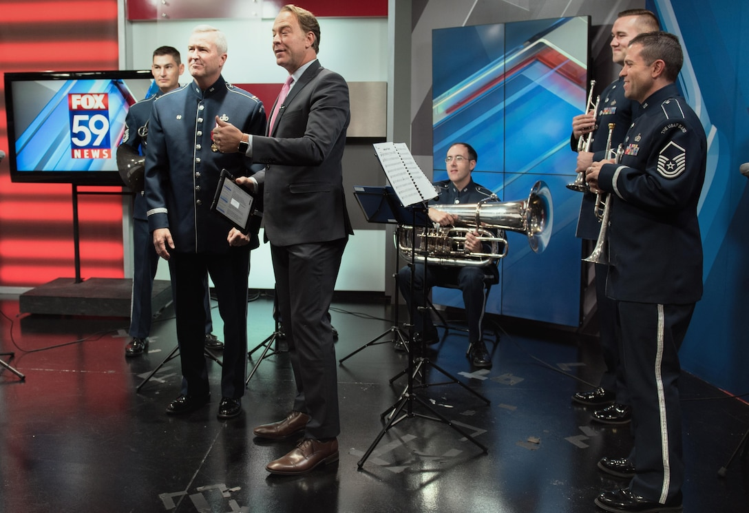 Col. Lang and the USAF Band Brass Quintet make an appearance with local television in Indianapolis, IN. (U.S. Air Force photo courtesy of CMSgt Bob Kamholz/Released)