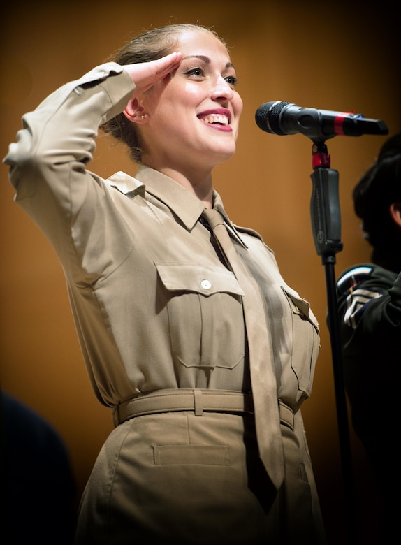 Performing on her first tour, TSgt Hillary Grobe appears in the Pinks and Greens costume of the Glenn Miller era. (U.S. Air Force Photo courtesy of CMSgt Bob Kamholz/Released)
