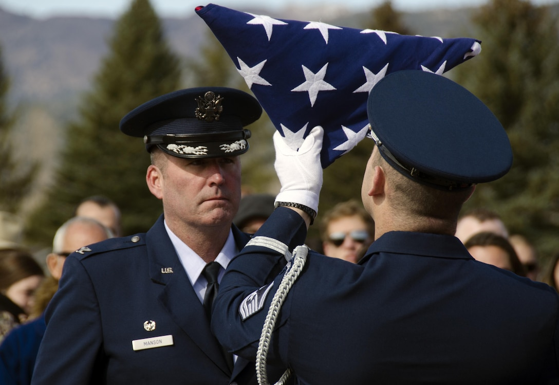 Manson presented flag by Hill