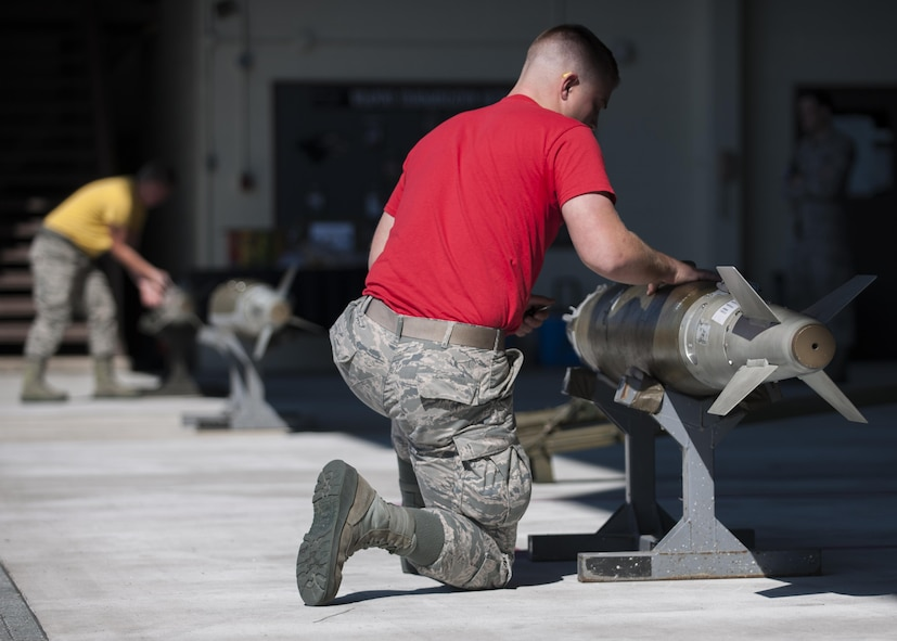 U.S. Air Force Senior Airman Joseph David, Wisconsin Air National Guard 115th Fighter Squadron weapons load crew member, inspects munitions during a weapons load competition at Kunsan Air Base, Republic of Korea, Oct. 20, 2017. The Wisconsin Air National Guard 115th Fighter Wing, along with the 80th Aircraft Maintenance Unit and the 35th Aircraft Maintenance Unit competed in a weapons load competition for the first time during the 115th FW's theater security package deployment to the Wolf Pack. (U.S. Air Force photo by Staff Sgt. Victoria H. Taylor)