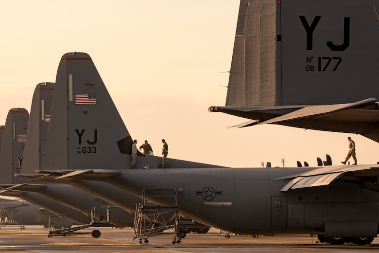 Crew chiefs assigned to the 374th Aircraft Maintenance Squadron perform maintaining a C-130J Super Hercules at Yokota Air Base, Japan, Nov. 3, 2017.