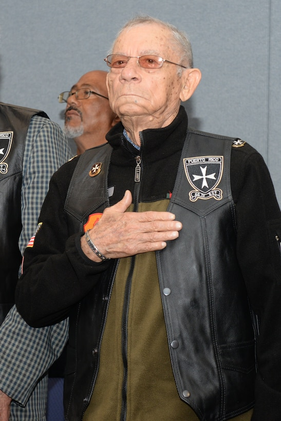 Vicente Arroyo, a retired U.S. Army 65th Infantry Regiment member, stands for the national anthem during a Hispanic Heritage Month celebration at New York Air National Guard's 106th Rescue Wing in Westhampton Beach, New York October 15, 2017. The U.S. Territory of Puerto Rico made up the 65th Regiment, best known as the Borinqueneers, and were guests of honor at the celebration for their contributions during both World Wars and the Korean War. (U.S. Air National Guard photo by Airman 1st Class Daniel H. Farrell)