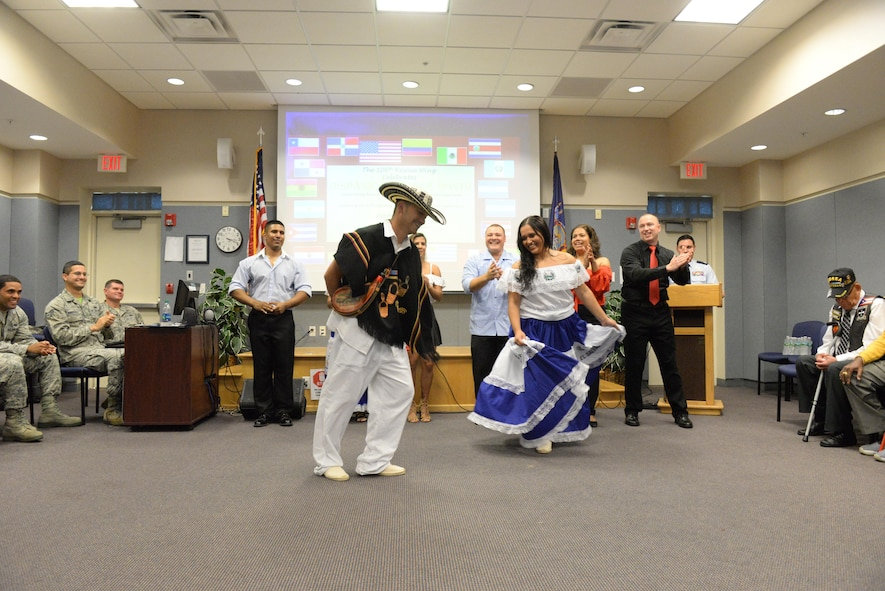 New York Air National Guard's 106th Rescue Wing's U.S. Air Force Master Sgt. Andres M. Velasquez, 106th Security Forces training manager, and U.S. Air Force Staff Sgt. Wendy Crow, 106th Health Services manager, dance during a Hispanic Heritage Month celebration at the 106th Rescue Wing in Westhampton Beach, New York October 15, 2017. In addition to showcasing the traditional dancing styles of various Hispanic cultures, the 106th also paid tribute to the U.S. Army 65th Infantry Regiment, known as the Borinqueneers, for their contributions during both World Wars and the Korean War. (U.S. Air National Guard photo by Airman 1st Class Daniel H. Farrell)