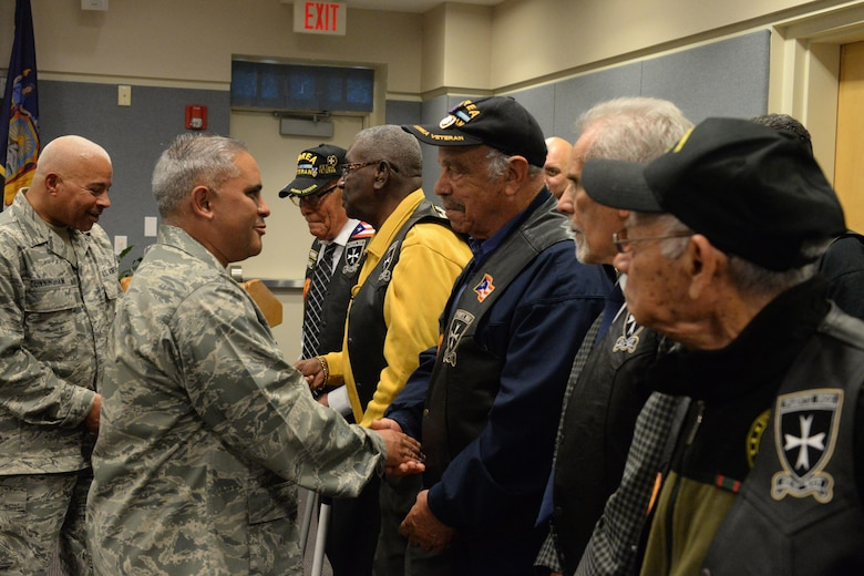 The Borinqueneers are presented with 106th Rescue Wing coins during a Hispanic Heritage Month celebration at New York Air National Guard's 106th Rescue Wing in Westhampton Beach, New York October 15, 2017. The event honored the Borinqueneers, the U.S. Army's 65th Infantry Regiment made up by the U.S. Territory of Puerto Rico, who served during both World Wars and the Korean War. (U.S. Air National Guard photo by Airman 1st Class Daniel H. Farrell)
