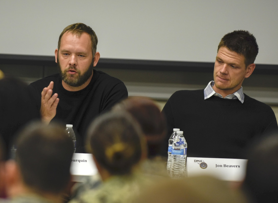 Iraq War veteran Eric Bourquin, left, talks about being part of The Long Road Home, a TV miniseries based on the Black Sunday ambush in Sadr City where he and other 1st Cavalry Division Soldiers fought in, during a panel discussion at the Defense Information School on Fort Meade, Md., Oct. 26, 2017. Bourquin and fellow veteran Aaron Fowler served as production consultants for the show. (Photo Credit: U.S. Army photo by Staff Sgt. Michael ONeal)