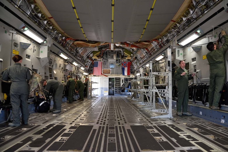 Members of the Air Force Reserve 36th Aeromedical Evacuation Squadron and other Air National Guard units prepare a C-17 Globemaster III aircraft from the 183rd Airlift Squadron to receive simulated patients Oct. 30, 2017, during Southern Strike 2018 at the Gulfport Combat Readiness Training Center, Mississippi. Southern Strike 2018 is a large-scale, joint multinational combat exercise that provides tactical level training for the full spectrum of conflict and emphasizes air dominance, maritime operations, maritime air support, precision engagement, close air support, command and control, personnel recovery, aeromedical evacuation, and combat medical support. (U.S. Air Force photo by Tech. Sgt. Ryan Labadens)