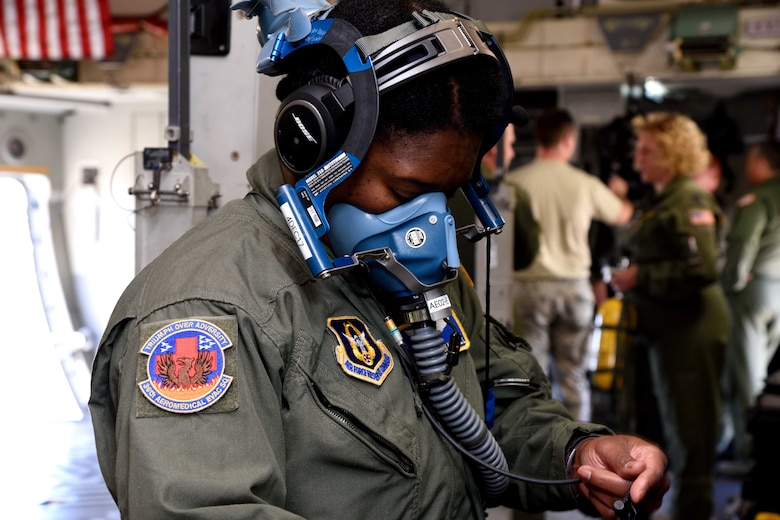 Master Sgt. Kimelyn Hall, 36th Aeromedical Evacuation Squadron aeromedical evacuation technician, tests her self-contained breathing apparatus on a C-17 Globemaster III aircraft from the 183rd Airlift Squadron during Southern Strike 2018 at the Gulfport Combat Readiness Training Center, Mississippi, Oct. 30, 2017. Southern Strike 2018 is a large-scale, joint multinational combat exercise that provides tactical level training for the full spectrum of conflict and emphasizes air dominance, maritime operations, maritime air support, precision engagement, close air support, command and control, personnel recovery, aeromedical evacuation, and combat medical support. (U.S. Air Force photo by Tech. Sgt. Ryan Labadens)