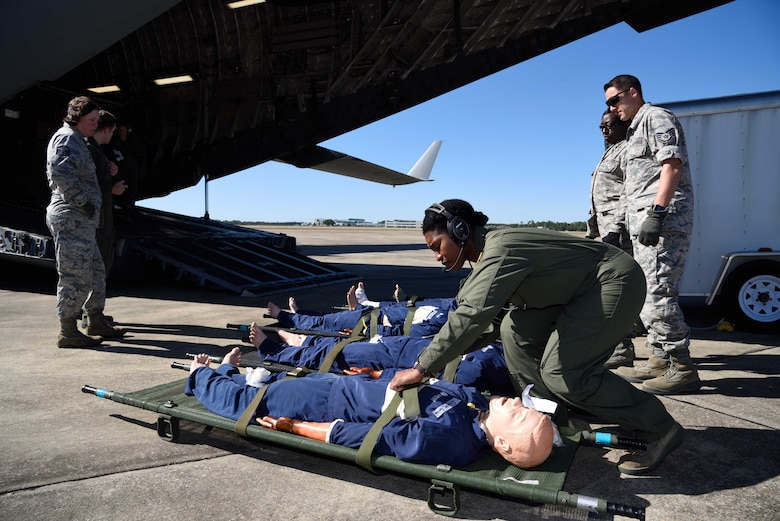 Master Sgt. Kimelyn Hall, 36th Aeromedical Evacuation Squadron aeromedical evacuation technician, ensures simulated patients are secured to their litters before being loaded onto a C-17 Globemaster III aircraft during Southern Strike 2018 at the Gulfport Combat Readiness Training Center, Mississippi, Oct. 30, 2017. Southern Strike 2018 is a large-scale, joint multinational combat exercise that provides tactical level training for the full spectrum of conflict and emphasizes air dominance, maritime operations, maritime air support, precision engagement, close air support, command and control, personnel recovery, aeromedical evacuation, and combat medical support. (U.S. Air Force photo by Tech. Sgt. Ryan Labadens)
