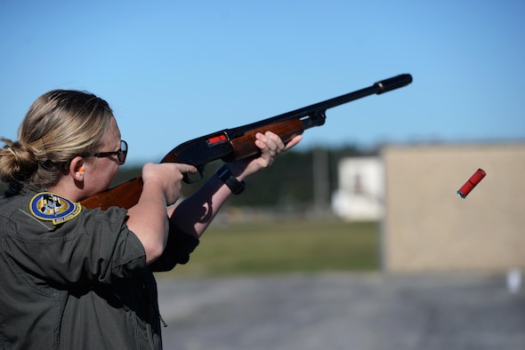 Capt. Taylin Eckols, 48th Flying Training Squadron instructor pilot, fires at a clay target Oct. 26, 2017, on Columbus Air Force Base, Mississippi. Instructor pilots competing in the turkey shoot event shot at 25 flying targets for a possible total of 100 points for this piece of the competition. (U.S. Air Force photo by Airman 1st Class Keith Holcomb)