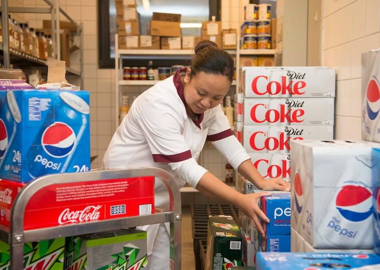 Bernadette Hamedou, 786th Force Support Squadron Rheinland Inn food service worker, arranges beverage boxes on Ramstein Air Base, Germany, Nov. 3, 2017. The Rheinland Inn offers a wide variety of beverages, entrees and snacks. (U.S. Air Force photo by Senior Airman Elizabeth Baker)