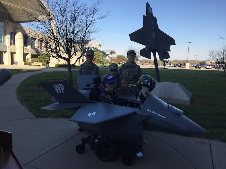 Dillon Rosenlieb, (center) surrounded by his siblings, showcases his F-35 Lightning II fighter jet Halloween costume.  The F-35 Division at Wright-Patterson Air Force Base and volunteers from the Magic Wheelchair organization worked together to build the costume for Dillon. (Courtesy photo)