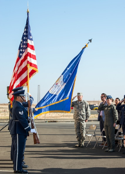 The honor guard present the Colors during a ceremony honoring OSI agent David Wieger during at Travis Air Force Base, Calif., Nov. 1, 2017. Wieger was killed in 2007 when an improvised explosive device struck his vehicle during his deployment in support of Operation Iraqi Freedom. The Office of Special Investigation, 12th Field Investigation Squadron, unveiled the renaming of their building to the fallen OSI agent. Wieger was stationed at Travis at the time and was posthumously awarded the Bronze Star, Purple Heart, AF Commendation Medal, and AF Combat Action Medal. (U.S. Air Force photo by Louis Briscese)