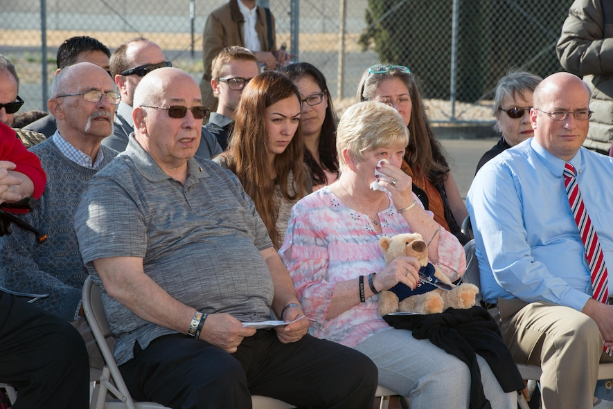 Loreene Wieger, mother of OSI agent David Wieger weeps during a ceremony honoring her Son at Travis Air Force Base, Calif., Nov. 1, 2017. David Wieger was killed in 2007 when an improvised explosive device struck his vehicle during his deployment in support of Operation Iraqi Freedom. The Office of Special Investigation, 12th Field Investigation Squadron, unveiled the renaming of their building to the fallen OSI agent. Wieger was stationed at Travis at the time and was posthumously awarded the Bronze Star, Purple Heart, AF Commendation Medal, and AF Combat Action Medal. (U.S. Air Force photo by Louis Briscese)