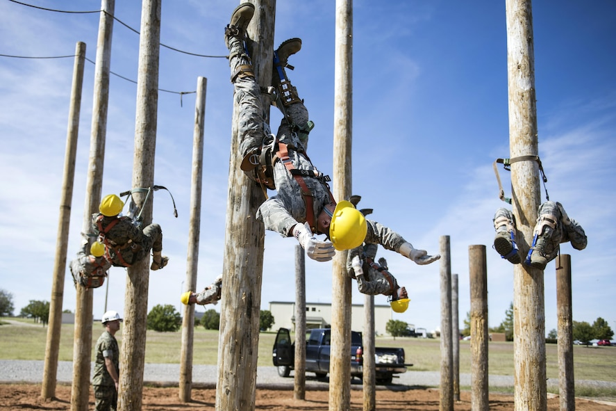 Airmen take part in a cable apprentice course at Sheppard Air Force Base, Texas, Oct. 18, 2017. During the training, instructors from the 364th Training Squadron taught the students how to safely climb wire poles and successfully perform their day-to-day mission. (U.S. Air Force photo by Alan R. Quevy)